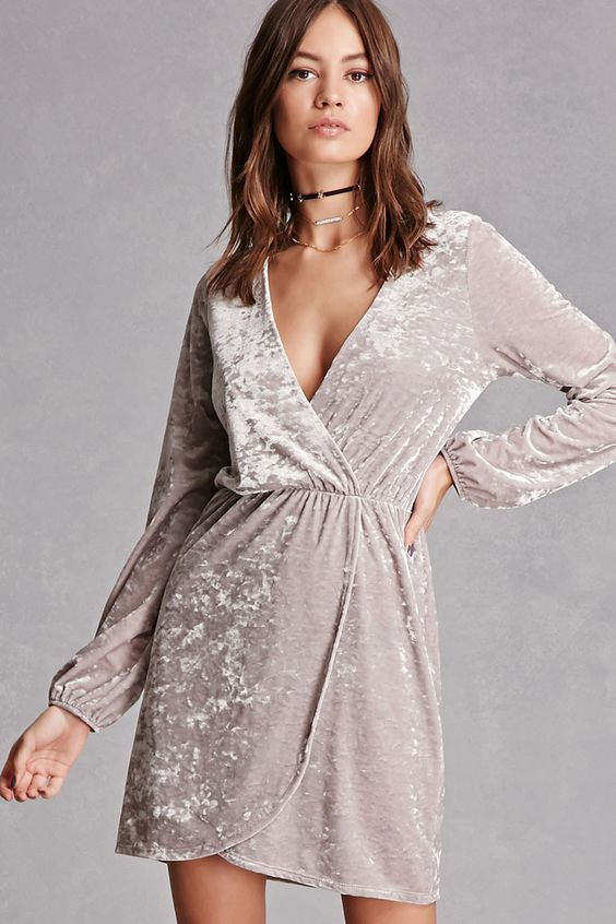 A knit crushed velvet dress featuring a surplice front, an elasticized waist, a mock wrap-front, and long sleeves with elasticized cuffs. This is an independent brand and not a Forever 21 branded item.