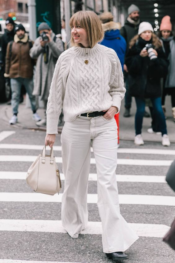 Oversized knit top and flared denim | For more style inspiration visit 40plusstyle.com