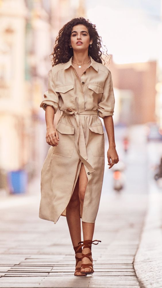 For a modern take on a classic trend, utility themes are refreshed with a minimalistic palette of white and tan to lend a new lightness. | H&M Spring & Summer Fashion