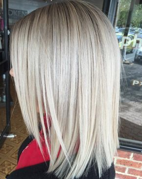 Blonde Layered Lob Layered front, shoulder length lob *straight cut back with the side sections angled sharply.