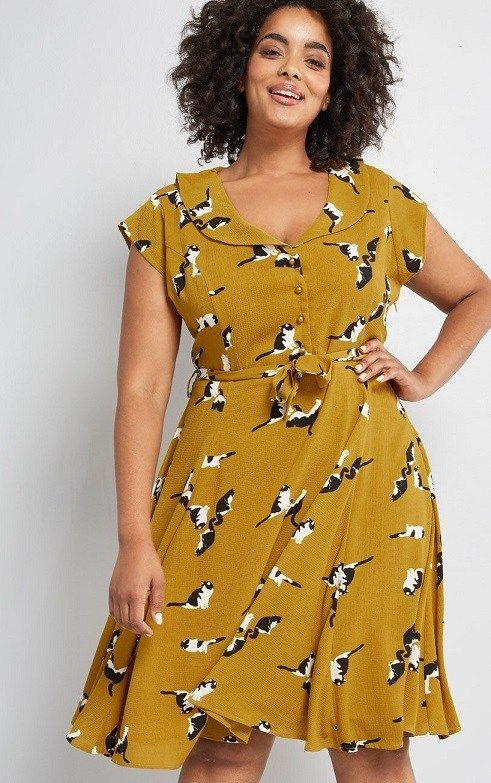 Yellow A-Line Dress Plus Size Cute Cat Print: This mustard yellow dress from Collectif! Given a retro spin this plus size dress, with its sweeping collar, cap sleeves, and pearly-buttoned bodice above a pleated skirt - all of which flaunt a quirky pattern of black and white cats A3 #PlusSizeDresses #getthelook #PlusSize #PlusSizeFashion #PlusSizeStyle #CurvyGirl #boldcurvyfashionista #curvesarein #curvesfordays #curvy #curvyfashionista #Fashion #Style #PlusSizeDresses