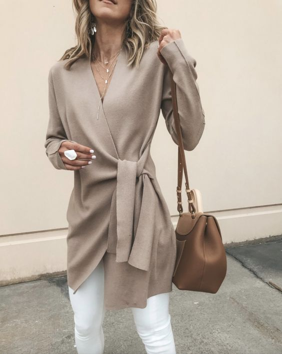 Fall Outfits: Beige cardigan, tan bag, white ring, white jeans and dainty necklaces. The best fall fashion to get you inspired. We feature fall outfits for school, fall outfits for work, winter fashion outfits, trendy fall outfits, fall clothing ideas, cold weather outfits, pretty fall outfits, clothes fall outfits and fall outfit inspo to make you look forward to the cold weather.