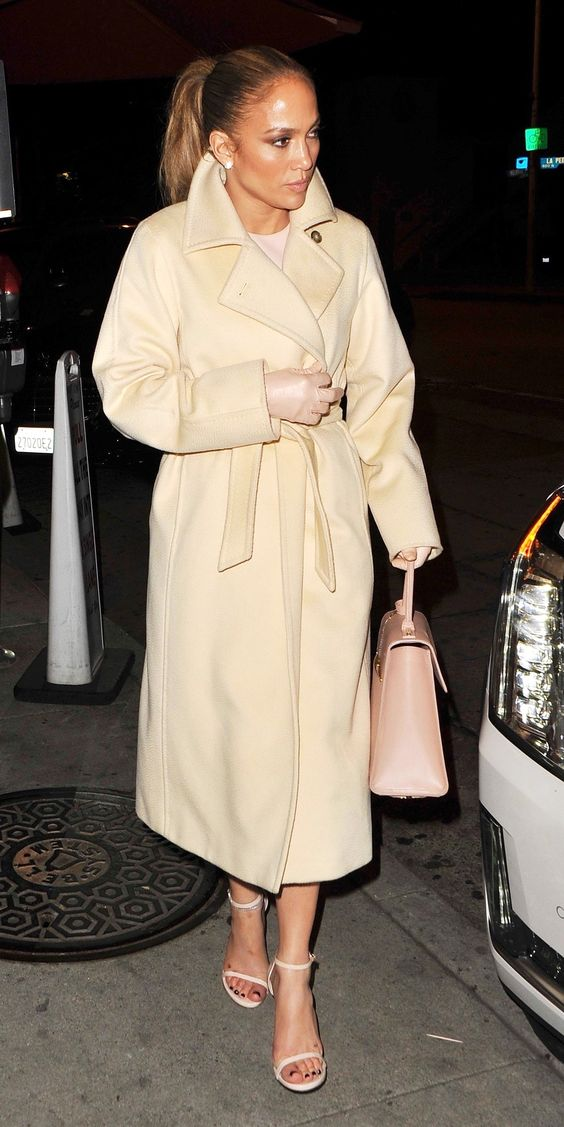 On a chilly spring evening in West Hollywood, Jennifer Lopez wrapped up in a tan coat styled with matching sandals and a satchel.
