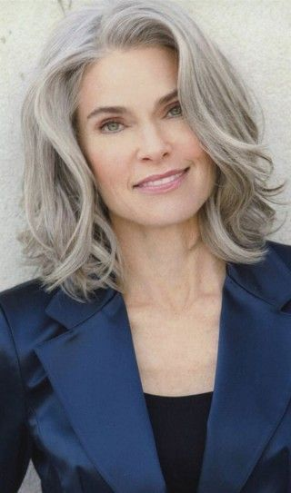 Hairstyles For Women Over 50 - Platinum Bob With Wavy Bangs #FashionTrendsForWomenOver50