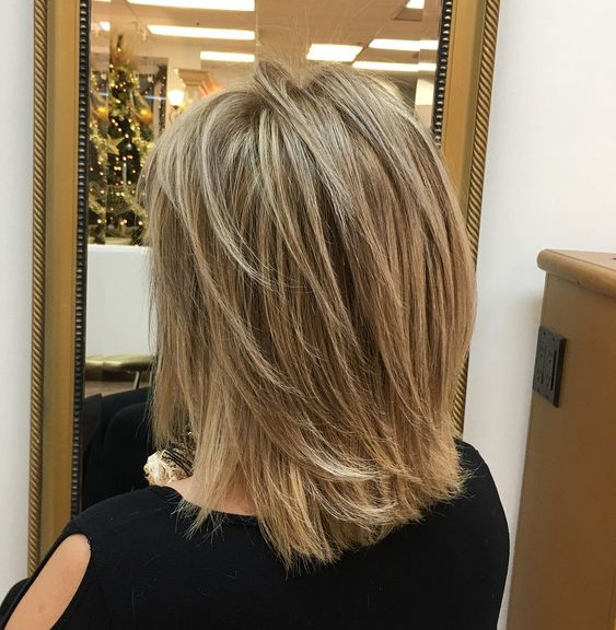 Feathered Mid-Length Style for Straight Hair